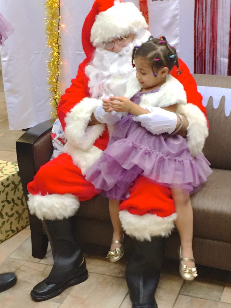 Jasmine telling Santa what she wants for Christmas