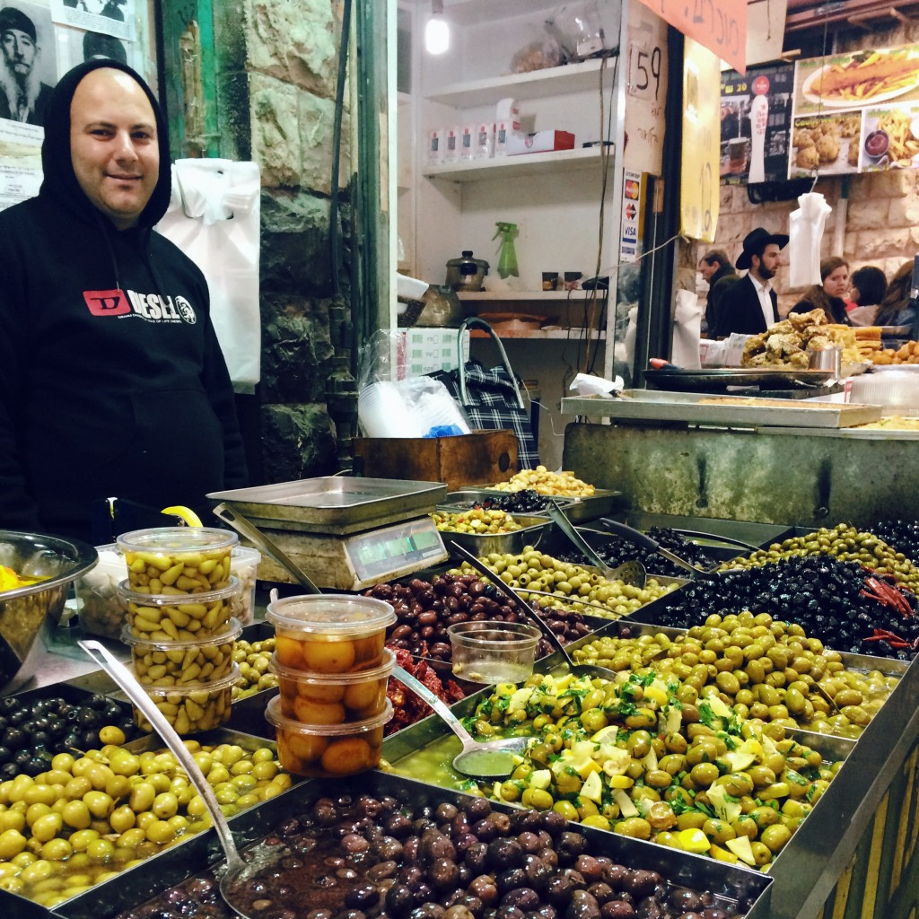 Olive vendor in Shouk Mahene Yehuda (market) Jerusalem